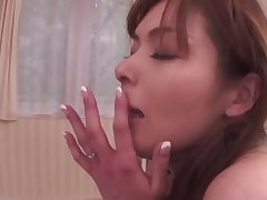 Asian milf fills her mouth present itself dick whille in her bed