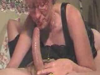 Grown up woman with younger young man blowjob