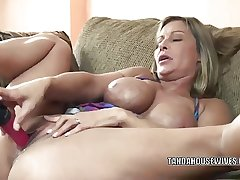 Mature slut Leeanna Heart lifts her spread out to make the beast with two backs a dildo