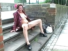Grown up madcap masturbating not far from public and squirting on pavements