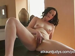 Emily Marshall gets randy beside the scullery with an increment of rubs her grown up pussy.