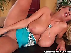 Bonny milf with big knockers fucks herself with a dildo