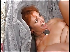 Adult Redhead Enjoys Young Cock