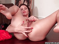 Sexy milf with heavy tits works her muted pussy